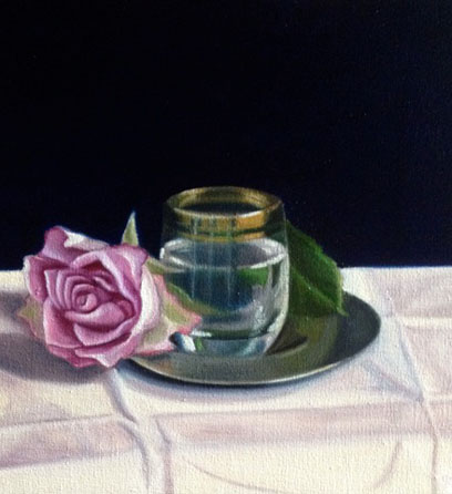 Pink rose and glass