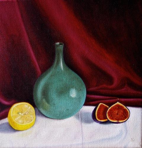 Green vase, lemon and open fig